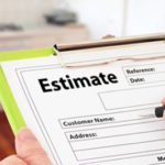 Contractor writing a customer estimate