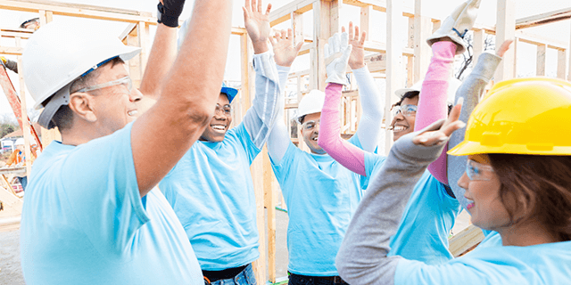 Construction crew volunteering to build a house